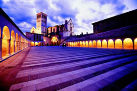 Assisi - the Basilica of San Francesco is even more evocative at sunset - De Agostini Picture Library